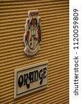 Small photo of Johannesburg , Gauteng / South Africa - June 23 2017:front of guitar amp, textured material, orange emblem,daytime close up
