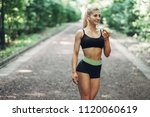 young sporty woman in a black... | Shutterstock . vector #1120060619
