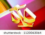 gold balance scales icon on the ... | Shutterstock . vector #1120063064
