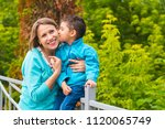 happy mom and son in the park   Shutterstock . vector #1120065749