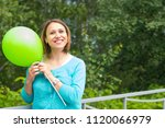 young smiling woman in the park ...   Shutterstock . vector #1120066979