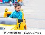 brunette boy rides an electric...   Shutterstock . vector #1120067411