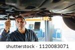 experienced car mechanic... | Shutterstock . vector #1120083071