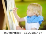 cute little boy drawing with... | Shutterstock . vector #1120101497
