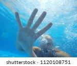 the face of a man under water. | Shutterstock . vector #1120108751