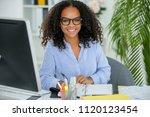 metisse secretary working in... | Shutterstock . vector #1120123454