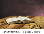 bible on a old oak wooden table.... | Shutterstock . vector #1120124591