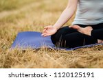 close up hands. woman do yoga... | Shutterstock . vector #1120125191