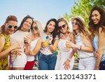 group of female friends posing... | Shutterstock . vector #1120143371