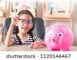 asian little girl smiling with...   Shutterstock . vector #1120146467