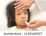 sick asia kid patient lying in... | Shutterstock . vector #1120160027