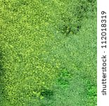 full frame abstract green foam background with paint remains - stock photo