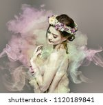 the lady of flowers is half... | Shutterstock . vector #1120189841