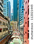 HONG KONG - JULY 30, 2012: view on downtown street on July 30, 2012 in Hong Kong. With a land mass of 1,104 km and 7 million people, Hong Kong is one of the most populated areas in the world - stock photo