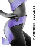 slim woman body, blue ribbon, black and white image - stock photo