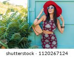 stylish beautiful woman in red... | Shutterstock . vector #1120267124