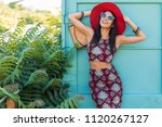 stylish beautiful woman in red... | Shutterstock . vector #1120267127
