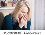 sad middle aged woman sitting... | Shutterstock . vector #1120284194