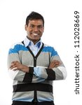 Portrait of handsome Indian man in casual clothes with his arms crossed. Isolated on white background. - stock photo