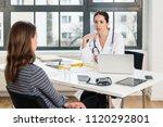 dedicated doctor listening to... | Shutterstock . vector #1120292801