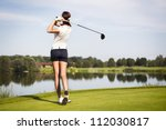 Girl golf player with driver...