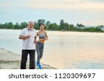 senior man and active young... | Shutterstock . vector #1120309697