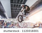 teenage bmx rider is performing ... | Shutterstock . vector #1120318301