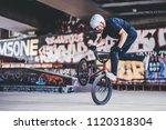 teenage bmx rider is performing ... | Shutterstock . vector #1120318304