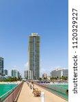 view to coastline of sunny... | Shutterstock . vector #1120329227