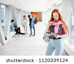 red haired girl student with... | Shutterstock . vector #1120339124
