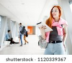 red haired girl student with... | Shutterstock . vector #1120339367