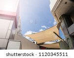 white sunshade with cloudy blue ... | Shutterstock . vector #1120345511