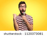 man with glasses singing with... | Shutterstock . vector #1120373081