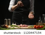 chef salts steak grill pan.... | Shutterstock . vector #1120447154