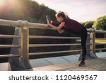 sport woman stretching in the... | Shutterstock . vector #1120469567