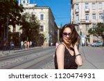 merry tanned brunette model... | Shutterstock . vector #1120474931