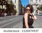 pleased tanned brunette girl... | Shutterstock . vector #1120474937