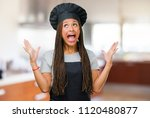 portrait of a young black baker ... | Shutterstock . vector #1120480877