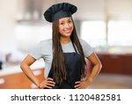 portrait of a young black baker ... | Shutterstock . vector #1120482581