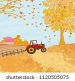 tractor plowing field in autumn | Shutterstock . vector #1120505075