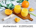 fresh orange juice in the glass ... | Shutterstock . vector #1120516181