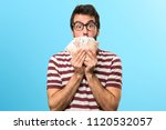 man with glasses taking a lot... | Shutterstock . vector #1120532057