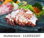 Small photo of Tray of fresh sliced octopus or tako sashimi, traditional Japanese food.