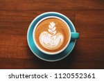 a cup of cappuccino with... | Shutterstock . vector #1120552361