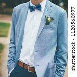 bridegroom with blue bow tie... | Shutterstock . vector #1120560977