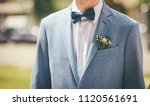 bridegroom with blue bow tie... | Shutterstock . vector #1120561691