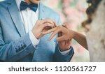 bridegroom put an engagement... | Shutterstock . vector #1120561727