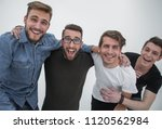 four cheerful young guys stand... | Shutterstock . vector #1120562984