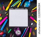 school supplies on blackboard... | Shutterstock . vector #1120586084