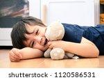 portrait cute  boy cuddle teddy ... | Shutterstock . vector #1120586531